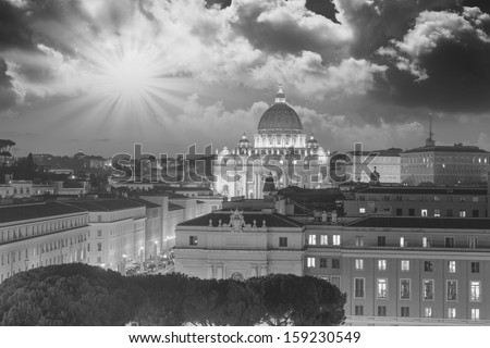 Buildings of Rome with Vatican St Peter Dome in background - sunset view. - stock photo