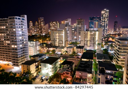 Buildings of the city of Waikiki Beach at night - stock photo