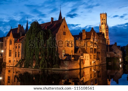 Buildings on canal at night in Bruges, Belgium