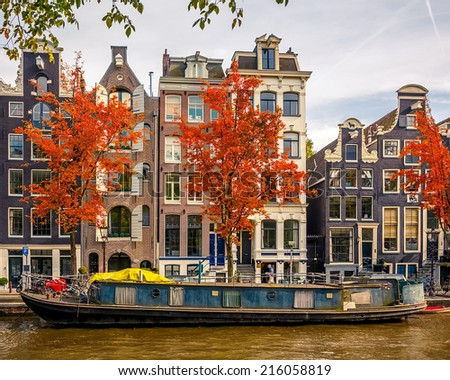 Buildings on canal in Amsterdam, Netherlands - stock photo