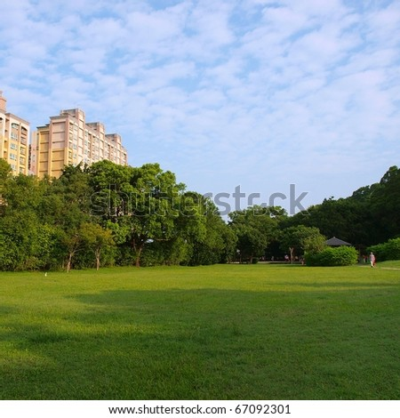 Buildings on green field - stock photo