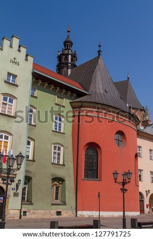 Buildings on small square in old town of Krakow - stock photo