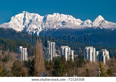 Buildings over gorgeous mountain.