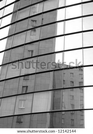 Buildings reflected in mirror glass - stock photo