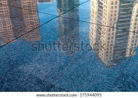 Buildings reflection in street - stock photo