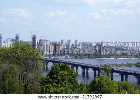 Buildings, river and bridge in Kiev, Ukraine