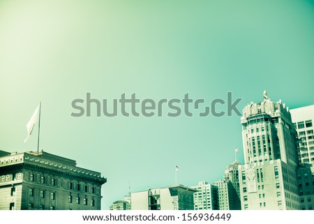 Buildings roof tops on clear sky. Green retro filter - stock photo