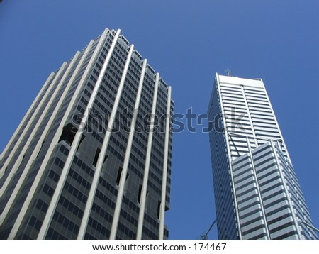 Buildings stretch into sky - stock photo