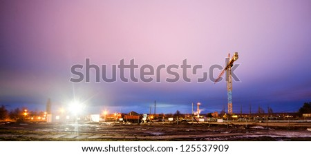 buildings under construction with cranes at evening - stock photo