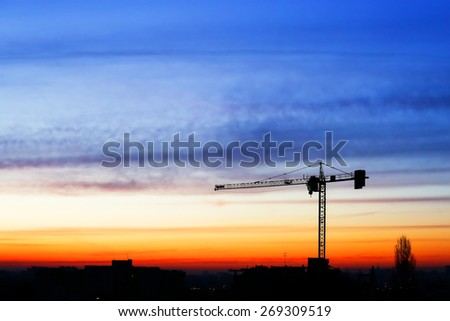 buildings under construction with sunset - stock photo