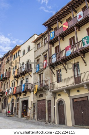 Buildings with medieval shields at the Piazza Grande in Arezzo, Italy - stock photo