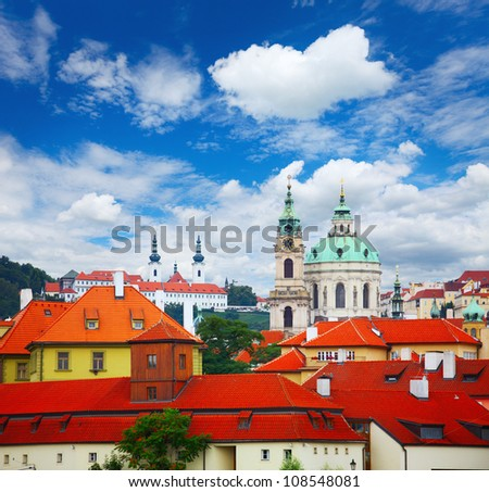Buildings with red roofs in the Prague at sunny day - stock photo