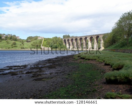Built between 1847 and 1850 the Royal Border Bridge is a Grade I listed railway viaduct  that carries the East Coast main line across the River Tweed at Berwick-upon-Tweed. - stock photo