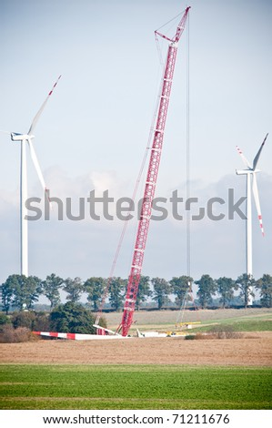 built wind farm with big red crane - stock photo