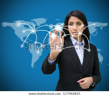 Buinesswoman pressing on holographic screen with connecting lines on world map background - stock photo
