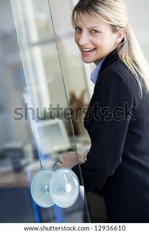 buisiness woman or office worker on her way to work, or a happy customer entering a bank etc. - stock photo
