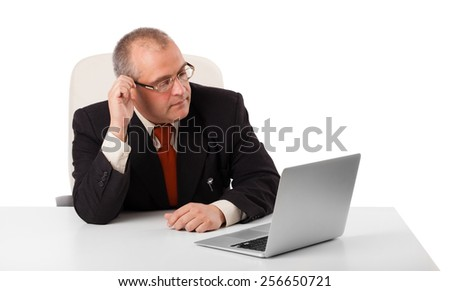 buisnessman sitting at desk and looking laptop with copy space, isolated on white - stock photo