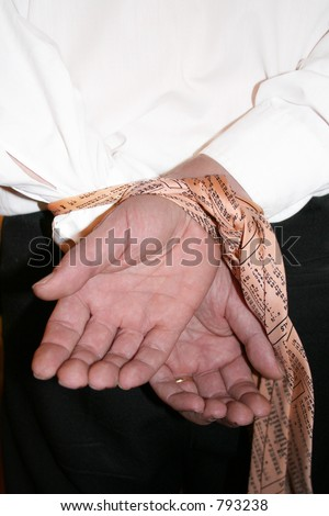 Buisnessman with hands tied on Buisness Decision with his Financial Stock Tie. - stock photo