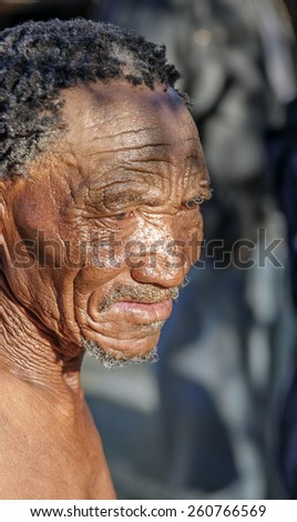 BUITEROS, NAMIBIA - JULY 17, 2014: Close-up portrait hunter Bushman. The San people, also known as Bushmen are members of various indigenous hunter-gatherer peoples of Southern Africa - stock photo