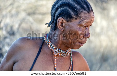 BUITEROS, NAMIBIA - JULY 17, 2014: Portrait of a woman Bushmen. The San people, also known as Bushmen are members of various indigenous hunter-gatherer peoples of Southern Africa - stock photo