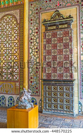 BUKHARA, UZBEKISTAN - APRIL 29, 2015: The tiled stove is built in wall of the dining room in Sitorai Mokhi-Khosa Palace, on April 29 in Bukhara.