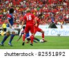 BUKIT JALIL - JULY 16 : Liverpool's Alberto Aquilani (red) is tackled by a Malaysian defender in their game at the National Stadium on July 16, 2011, Bukit Jalil, Malaysia. Liverpool won 6-3. - stock photo