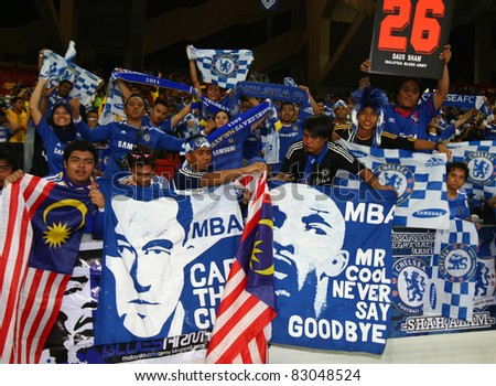 BUKIT JALIL, MALAYSIA - JULY 21: Chelsea FC fans show support and adoration during the team's match against Malaysia in the National Stadium on July 21, 2011 in Bukit Jalil, Malaysia. - stock photo
