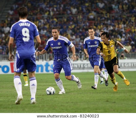 BUKIT JALIL, MALAYSIA - JULY 21: Chelsea FC's Frank Lampard dribbles forward in this match against Malaysia in the National Stadium on July 21, 2011 in Bukit Jalil, Malaysia. Chelsea won 1-0.