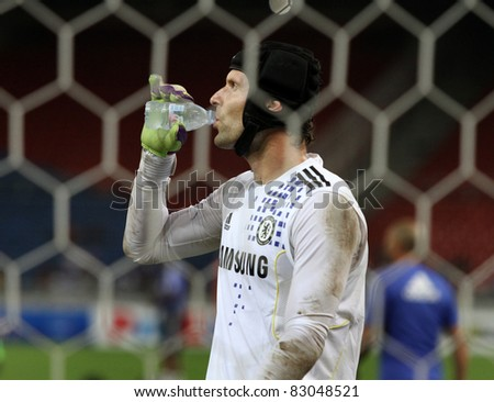 BUKIT JALIL, MALAYSIA - JULY 19: Chelsea's goalkeeper Peter Cech takes a break during the team's practice session in the National Stadium on July 19, 2011 in Bukit Jalil, Malaysia. - stock photo
