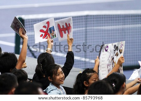 BUKIT JALIL, MALAYSIA- OCT 01: Fans and supporters of Japan's Kei Nishikori show their support in this semi-final match of the Malaysian Open  on October 01, 2011 in Putra Stadium, Bukit Jalil, Malaysia. - stock photo