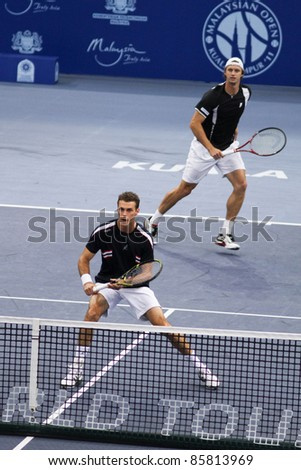 BUKIT JALIL - OCT 01: Filip Polasek (cap) and Frantisek Cermak reacts in this Malaysian Open semi-final doubles game against Melzer/Petzschner on Oct 01, 2011 in Putra Stadium, Bukit Jalil, Malaysia.