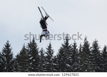 BUKOVEL, UKRAINE - FEBRUARY 23: Kiley McKinnon, USA performs aerial skiing during Freestyle Ski World Cup in Bukovel, Ukraine on February 23, 2013.