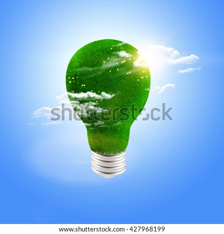 bulb covered with grass on blue background
