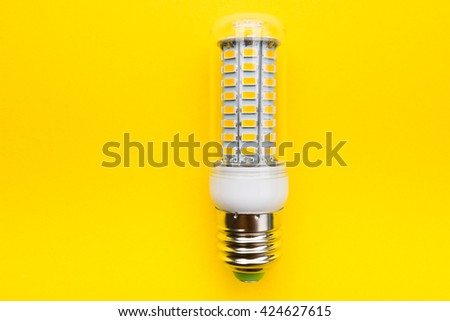 Bulb Electric lamp led corn on a yellow background - stock photo