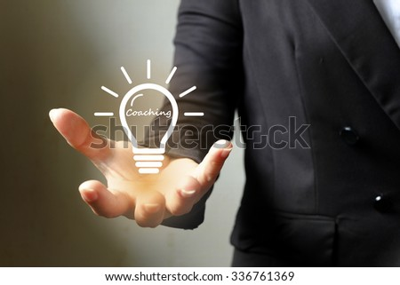 bulb gear coaching on hand , Business idea ,business concept