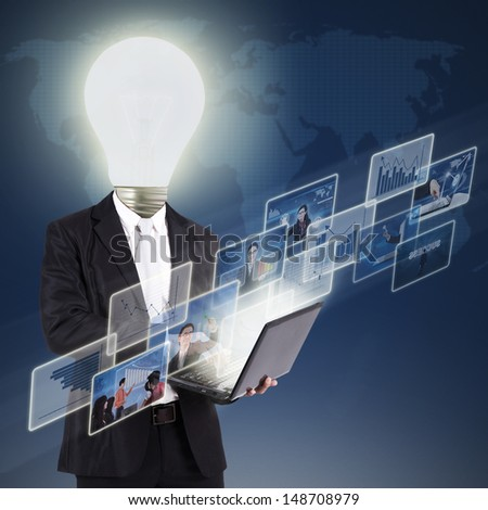 Bulb head businessman working on laptop with many transparent screen over a world map background