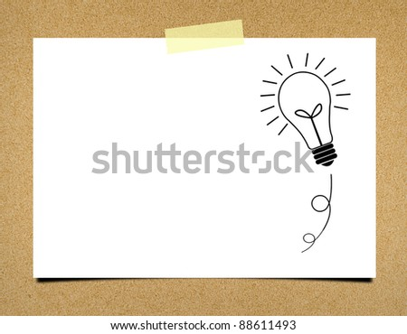 Bulb idea note paper on board background - stock photo