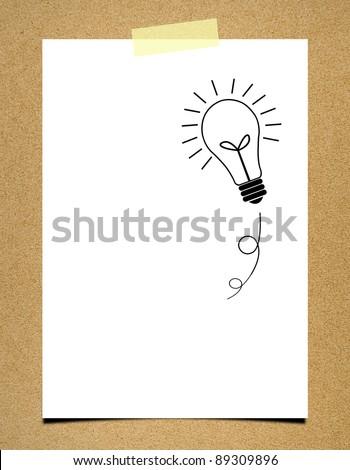 Bulb idea note paper on board background - stock photo