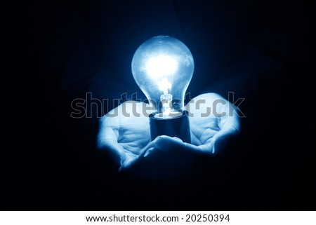 bulb in hand - stock photo