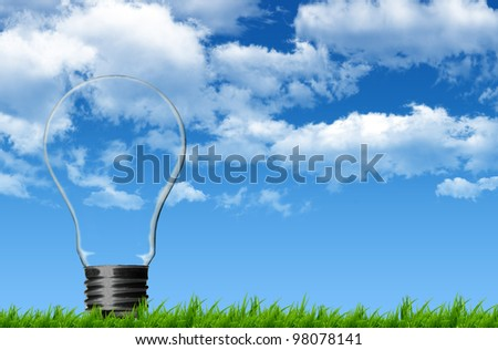 Bulb in the grass - stock photo