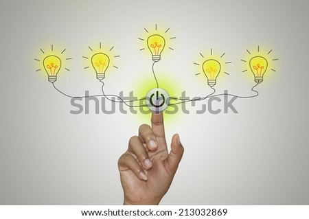 Bulb light and Fingertip on Grey background. - stock photo
