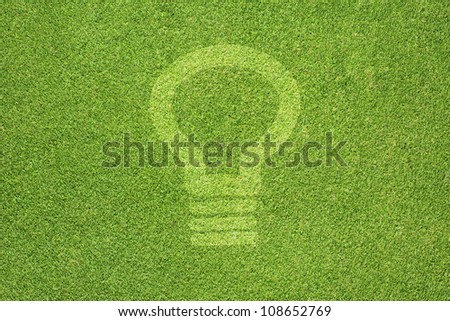 Bulb light icon on green grass texture and  background