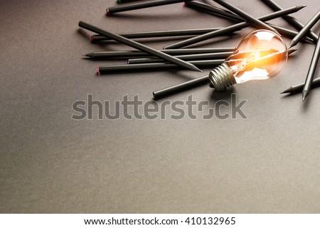 Bulb Light Idea Pencils Paper - Stock Image - stock photo