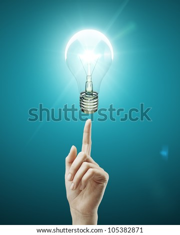 bulb light on women fingertip - stock photo
