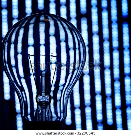 bulb on abstract background - stock photo