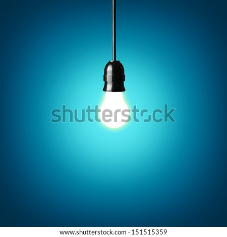 Bulb on blue background.Idea concept.