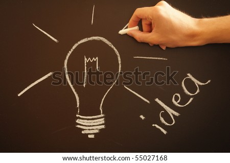 bulb on chalkboard showing idea creativity and innovation