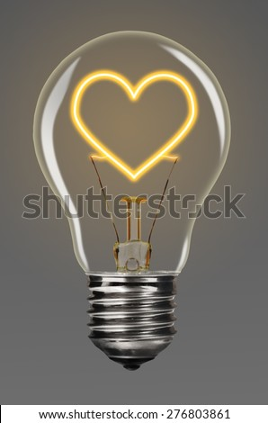 bulb with glowing heart inside of it, creativity concept - stock photo