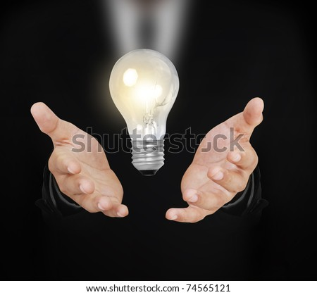 bulb With hand - stock photo