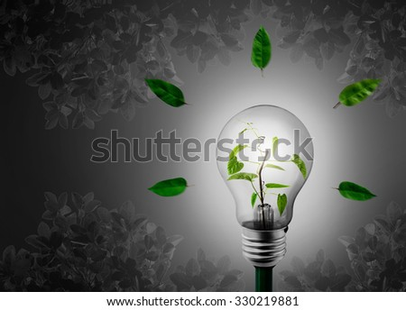 Bulb with tree inside on a Gary background. - stock photo